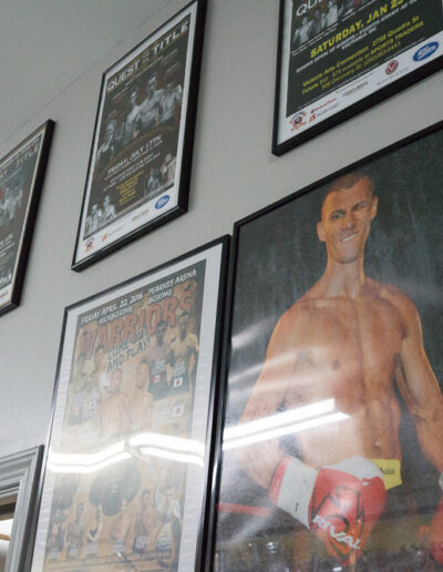 wall with photos and fight posters
